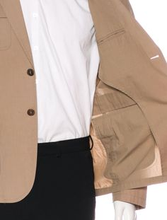 From the Spring 2012 Collection. Men's tan Gucci field jacket with notched lapels, four pockets and dual button closures.