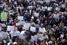 """French Muslim calls on peers to stop terrorism: 'The solution will come from us' Demonstrators attend a protest called """"Not in my name"""" of Italian muslims against terrorism in downtown Milan, Italy, November 21, 2015. REUTERS/Alessandro Garofalo"""