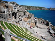 Ancient Greece? No, this is Cornwall. The Minack Theatre is an open-air theatre, constructed above a gully with a rocky granite outcrop jutting into the sea. The theatre is at Porthcurno, 4 miles from Land's End in Cornwall, England.