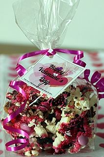 Pretty-in-Pink Popcorn Party Mix. Popcorn, chocolate drizzles, pink/red M&Ms. Fun classroom gift bag or party favor. Free printable tags, too!