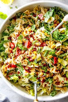 This BLT Pasta Salad recipe is bursting with not only crispy Bacon, crunchy Lettuce and juicy Tomatoes but asparagus, peas and peppers doused in AMAZING Lemon Chive Dressing for the most irresistible pasta salad ever! It's hearty, flavorful, super easy, make ahead friendly perfect for potlucks!