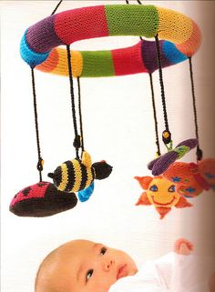 It would be fun to knit little animals and such for this cute mobile!