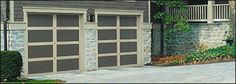 My wife and I have been looking into getting a new garage door for our house, because we were getting sick of the plain white one.  It also has several dents in it, so it should be replaced anyways.  We want to get something that matches the rest of our house better. Back when we built the house, all that they had back then were white ones, but now, you have so many different options.