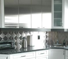 Stainless steals the show right now, and a kitchen planner I recently met with recommended a stainless steel backsplash as a unique way to update my cuisine. 50s Diner Kitchen, Dad's Kitchen, Kitchen Ideas, Stainless Backsplash, Kitchen Backsplash, Kitchen Counters, Kitchen Planner, Victorian Kitchen, Kitchen Upgrades