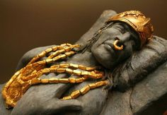 Gold jewelry adorns a display sculpture at the Gilcrease Museum. -  Panama