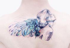 Breathtaking watercolor angel tattoo by Tattooist Banul