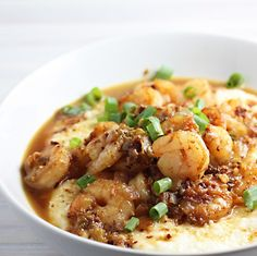 spicy cajun  shrimp and grits with gruyere cheese
