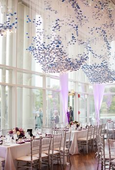 Brides.com: This Week's Best Wedding Ideas: April 11, 2014. Dramatic string lights and flowers in shades of purple hang from the ceiling at this upscale restaurant reception.   See more photos from Lindy and Nik's elegant Washington, D.C. wedding here.
