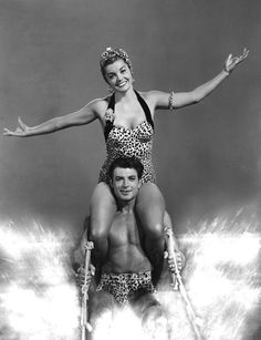 Esther Jane Williams (August 8, 1921 – June 6, 2013) was an American competitive swimmer and actress. Williams set multiple national and regional swimming records in her late teens as part of the Los Angeles Athletic Club swim team. Unable to compete in the 1940 Summer Olympics because of the outbreak of World War II, she joined Billy Rose's Aquacade, where she took on the role vacated by Eleanor Holm after the show's move from New York City to San Francisco.