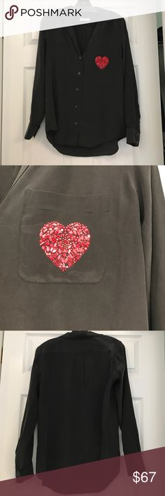 Equipment 100% silk dark grey/black blouse w heart Fun and classy dark grey almost black 100% silk Equipment blouse. Long sleeved and buttons up. Lower cut than a traditional blouse that makes it slightly sexy yet not so revealing. Beaded gem accent red heart to left pocket. Material is divine. Flawless condition - worn once. Size small. Equipment Tops Blouses
