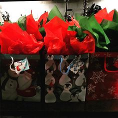 Baking packed and ready to go! Don't worry...more tasty recipes will be up #ontheblog soon! Stay tuned! #christmasbaking #treats #christmas #holidays #giftbags #instalike #instafollow #december #tissue #red #green #penguins