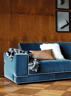 Fendi Casa Sloane sofa with vivid color and light piping itself outstanding but combine it with fur throw and leather pillow to make it special. Luxury Living