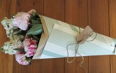 nice way to present flowers for the host