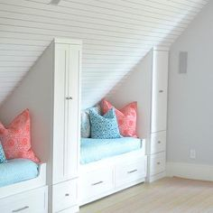 Attic bunk room features planked vaulted ceilings over built-in beds with storage dressed in pink .
