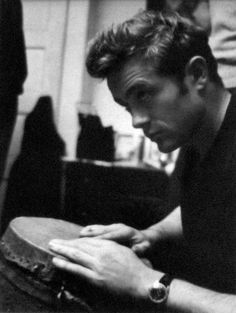 James Dean playing the bongo drums.