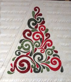 A Modern Swirly tree, quilted with channels and Modern Loops by Joyce Lundrigan.