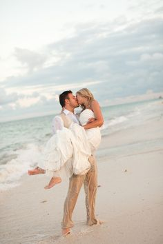 "I think this might be one of those ""trash the dress"" type beach wedding photos!"