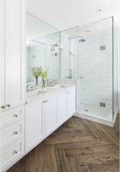 Master bathroom with herringbone wood floor, marble shower and countertops, white cabinets, double vanity Ali Budd Interiors Wood Bathroom, Bathroom Renos, Small Bathroom, Bathroom With Wood Floor, Bathroom Remodeling, White Master Bathroom, Master Shower, Tiled Bathrooms, Master Bathroom Layout