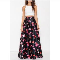 """Rose Skirt Gorgeous satin-finish, full-length ball skirt. Black with red and pink rose print. Worn one night for an event (see last photo - please note I'm 5'2"""" so this comes high on my waist. I'm wearing a crop top but there's not skin showing unless I lift my arms. Also had to wear heels so that it wasn't dragging, but it hit the floor). In like new condition. Size small fits a 2-4. Zipper and hook and loop closure in the back. Re-posh! Skirts A-Line or Full"""