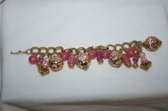 VINTAGE GOLD PLATE DANGLE BRACELET IN THREE SHADES OF PINK & ORNATE BEAD CAPS