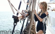 Actress Jennifer Aniston poses on a boat in Marie Claire