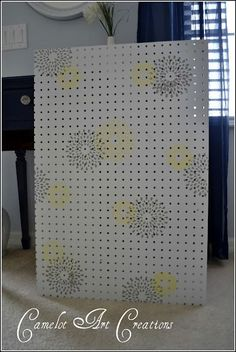 Stenciled Peg Board, for the office :)  i wonder could i use pegs to hold/organize thread?