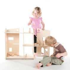 Modern Dollhouse, Modular Structure, Montessori inspired, dollhouses fun for all ages. $148.00, via Etsy.