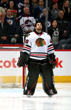 WINNIPEG, MB - FEBRUARY 10: Goaltender Corey Crawford #50 of the Chicago Blackhawks looks on during the singing of the National anthems prior to puck drop against the Winnipeg Jets at the MTS Centre on February 10, 2017 in Winnipeg, Manitoba, Canada. (Photo by Jonathan Kozub/NHLI via Getty Images)