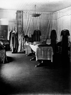 The showroom in the Palazzo Orfei, Venice, displaying Fortuny dresses, textiles, cushions and lamps. Photo by Mariano Fortuny.