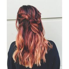 We love this bohemian braid paired with a red and gold balayage ombre. Image by stylist Bronte La Rue. Formula in comments.
