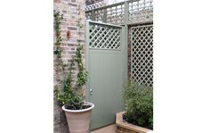 tongue and grove gate with trellis top panel in a pretty grey green - The Garden Trellis Company | Products | Bespoke Gates