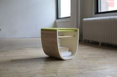 """Sit and Feel the Burn! The U-Stool's signature """"U"""" shape is functional in getting the user to work their abdomen and legs to balance the rocking seat. U-Stool by Richard Clarkson, Zena Verda Pesta and Clay Kippen"""