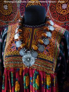 by Helen Nelson-Reed | Necklace; an old vintage Indian tribal pendant, is combined with vintage 1 rupee coins (late 70's.early 80's) and vintage African 'amber' resin beads | 345$ ~ sold