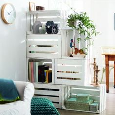Economic DIY way to divide a large room and create a semi see-through two way shelf.