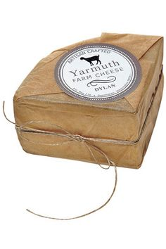 Maybe we don't even need to show the cheese - Use natural paper and twine with a rustic branded label to allow for a cleaner display. Dairy Packaging, Cheese Packaging, Milk Packaging, Pretty Packaging, Brand Packaging, Fromage Cheese, Charcuterie Cheese, Goat Cheese, Cheese Design