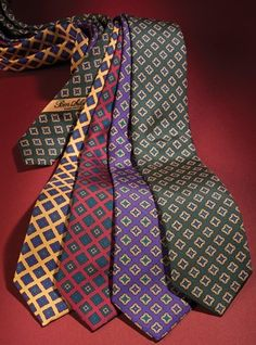 English printed silk neckties with a traditional square neat pattern, in a soft finish and in madder silk influenced colors. An elegant yet traditional touch, they are especially handsome with tweed jackets. Shown left to right: A-marigold with imperial; C-russet with tartan; D-pansy with marigold; E-rifle with marigold.