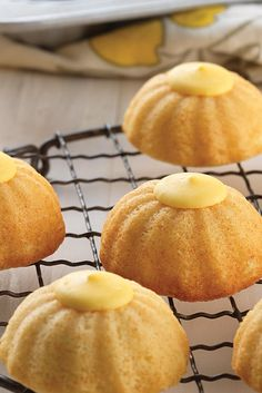 Mini Fluted Lemon Cakes Recipe. These charming, extra-tender (due to the cake flour!) little cakes pack a punch when it comes to lemon flavor. They'll brighten up any afternoon tea or dessert course, particularly when topped with our lemon wafers, which melt into creamy lemon lusciousness.