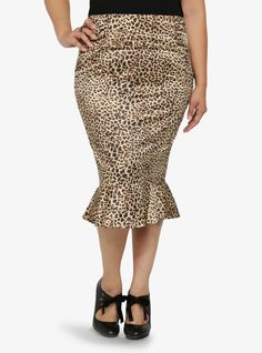 We're wild about this pencil skirt - the leopard print and a playful peplum hem give it a cool, retro vibe that is simultaneously flattering and oh-so-sexy.