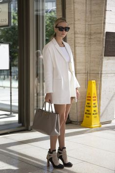 """New York Fashion Week street style inspiration (Vogue.com UK""""I'm wearing Celine sunglasses with a Prada bag, Balenciaga shoes, a Topshop coat and an American Apparel top and skirt."""""""