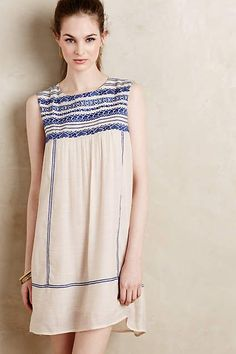 Would wear with skinny jeans and a cardigan (I like to cover my shoulders).  Rising Tide Swing Dress - anthropologie.com