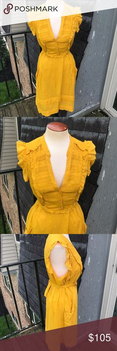 Anthropologie Odille Dress Odille Layered mustard yellow dress. Worn once, beautiful mustard yellow color. Three buttons in front. Lace lining. No flaws. Size 6. Bought from anthropologie. Anthropologie Dresses