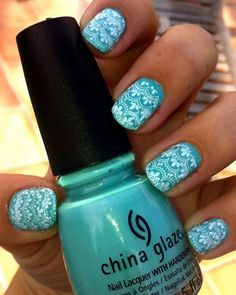 Nail Art ~ Light blue base used with a stamping tool to give the effect in white.