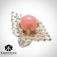 A wonderful, rare, conch pearl, set amidst diamonds, to form an elegant and…