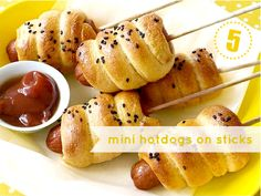 Mini hotdogs on sticks by Vanilla and Cinnamon. Click on the image to be taken to the site