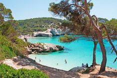 People bathing in the blue waters of Cala Mitjana on Menorca Menorca Beaches, Places To Travel, Places To Visit, Quick Travel, Travel Tips, Island Tour, Desert Island, Balearic Islands, Beautiful Castles