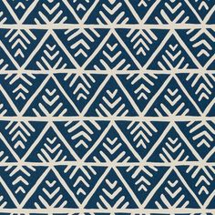 A stylish geometric in navy blue and white, featuring lines of zigzags and chevrons. Palampore by Anna French,Shop designer wallpapers online.