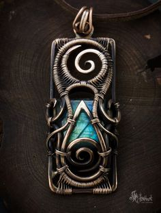 Tribal bronze square wire wrapped #pendant with flashy labradorite
