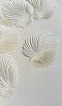 Gorgeous carved paper wall art by Domitilla Biondi. Click through to read about her work.