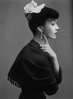 October 1950  Wearing Cristóbal Balenciaga's suit with capelet of black silk satin matelassé. Photographed by Richard Avedon.