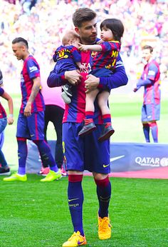 Gerard Pique and Shakira bring their boys Milan and Sasha to his soccer match on April 18, 2015